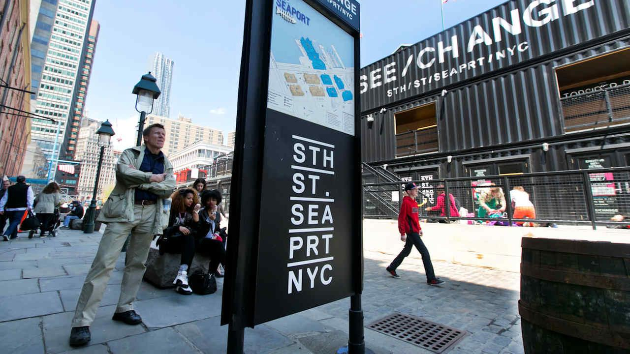 A visitor consults a map of South Street Seaport Museum in 2014 as the financially-troubled landmark charting a course toward revival after Superstorm Sandy