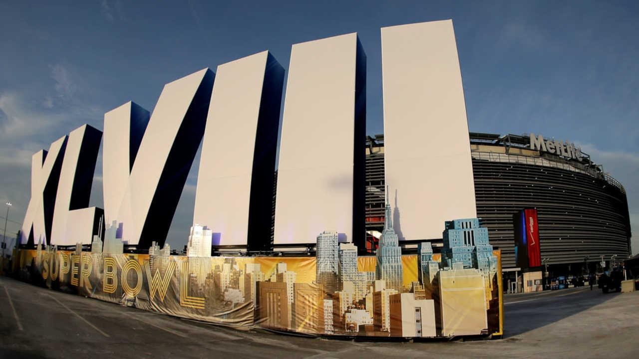 A sign for NFL footballs Super Bowl XLVIII stands in front of MetLife Stadium Sat. Feb. 1, 2014, in East Ruthoford, N.J.