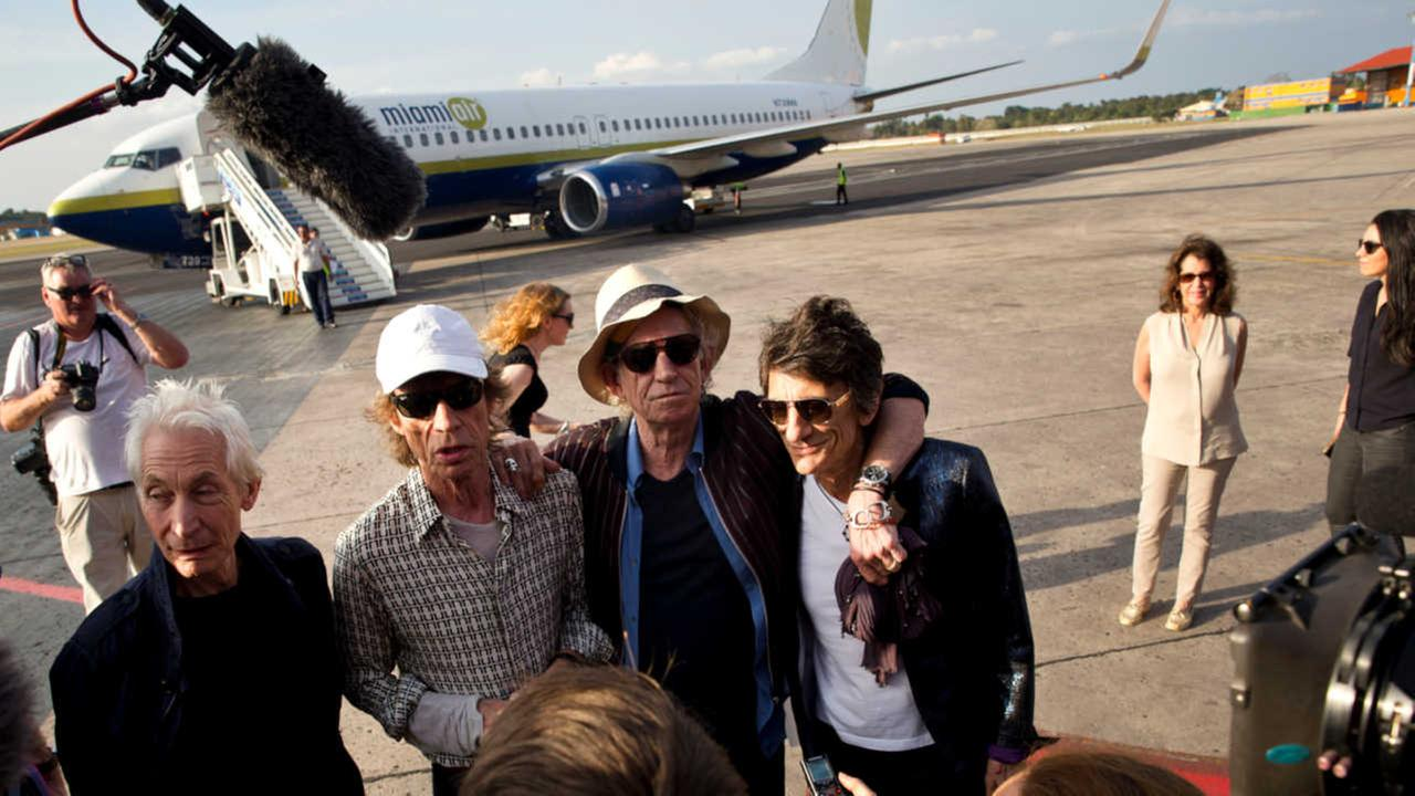 Members of The Rolling Stones - Charlie Watts, Mick Jagger, Keith Richards and Ron Wood talk to journalists upon their arrival to Jose Marti international airport in Havana