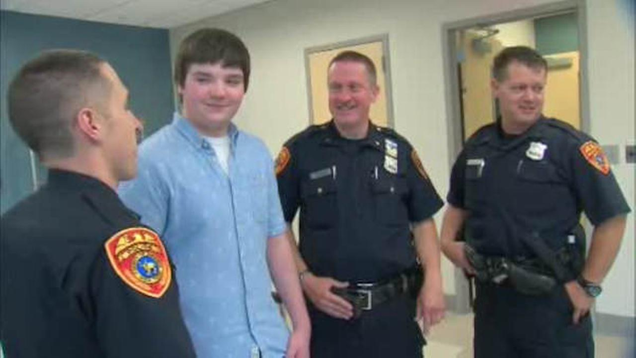 Teenager meets three officers who saved his life in emotional reunion