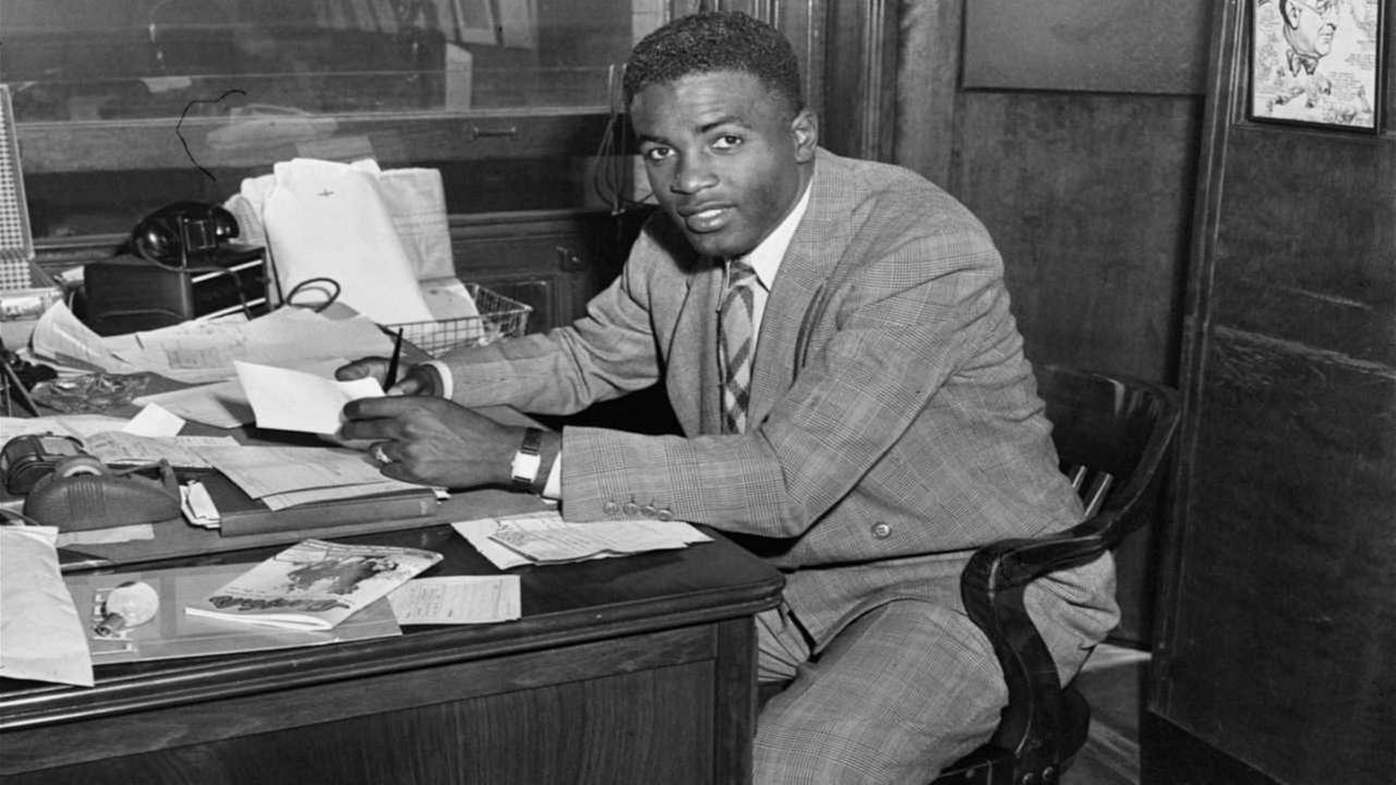 'Jackie Robinson, first African American to ever be admitted into the major leagues, photographed right after he signed his contract with the Brooklyn Dodgers1_b@b_1the Dodgers office.' from the web at 'http://cdn.abclocal.go.com/content/wabc/images/cms/1287824_1280x720.jpg'