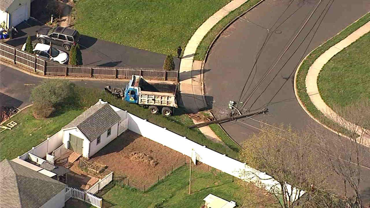Truck in Raritan runs into 2 power poles, ends up in driveway