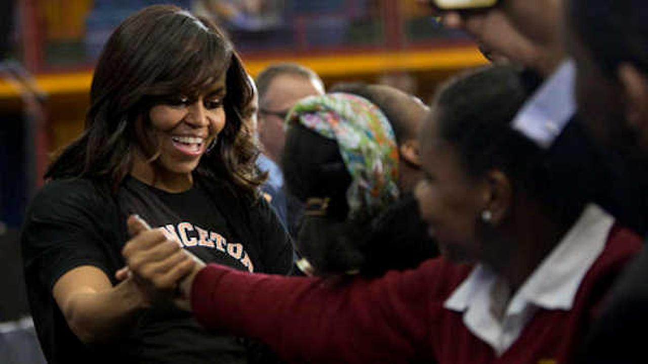 First lady Michelle Obama greets members of the audience while hosting the 2016 College Signing Day, Tuesday, April 26, 2016, in New York. (AP Photo/Mary Altaffer)