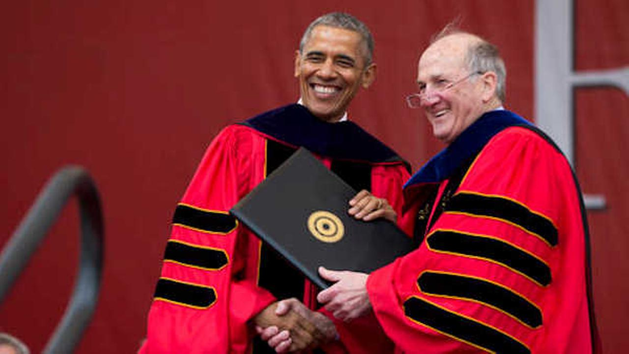 President Obama receives an honorary degree from Rutgers University President Robert Barchi during the commencement ceremony. (AP Photo/Evan Vucci)