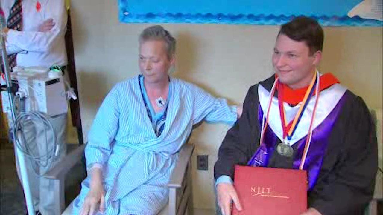 Hospital staff surprises father and son with graduation party
