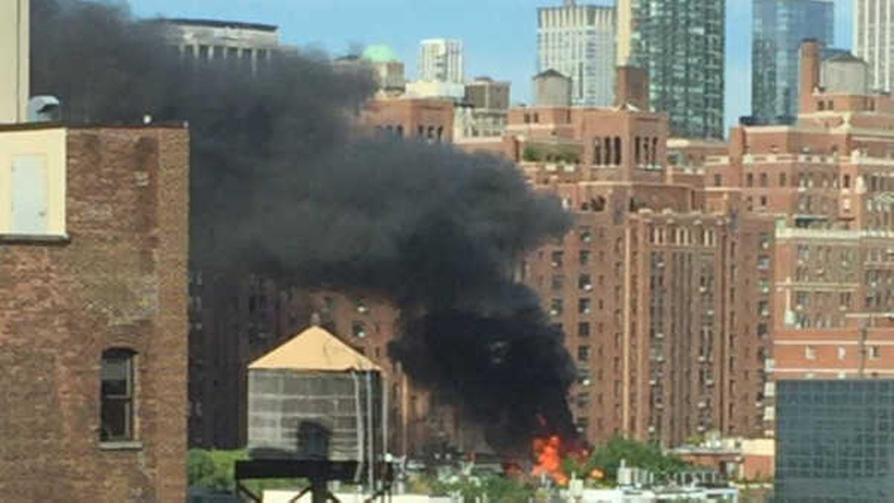 Firefighters battle fire on roof of Chelsea apartment building