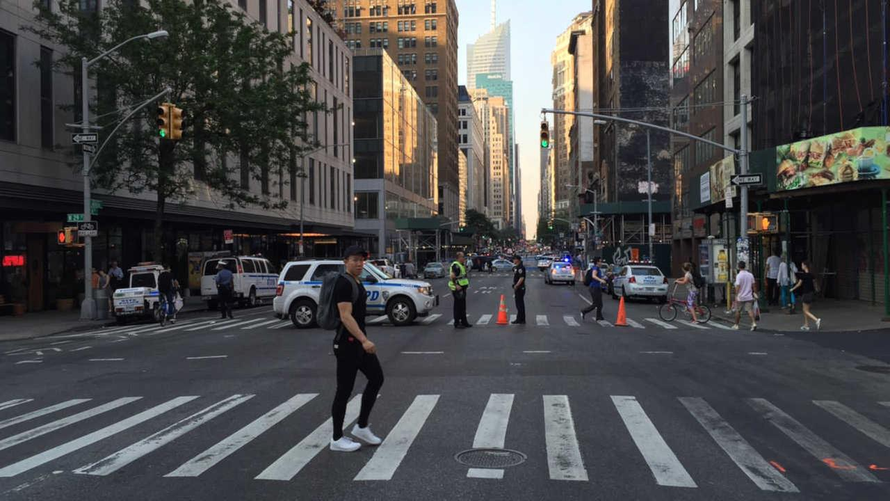woman killed while crossing street in midtown