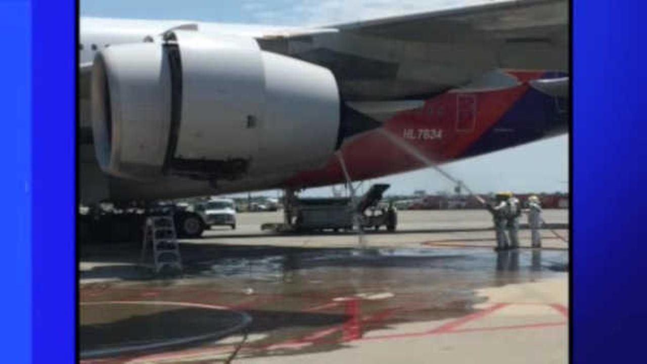 Engine fire breaks out on Asiana flight after landing at JFK Airport