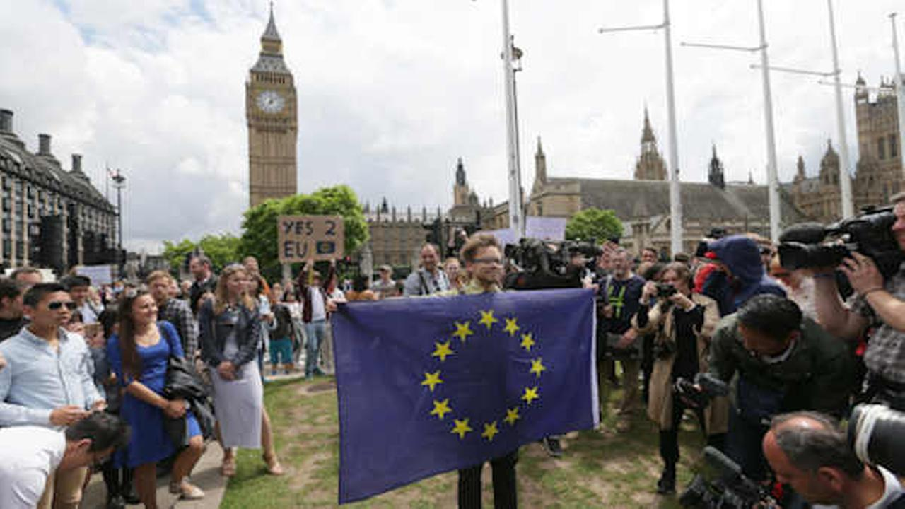 Demonstrators opposing Britains exit from the European Union in Parliament Square following the EU referendum result hold a protest in London (AP Photo/Tim Ireland)