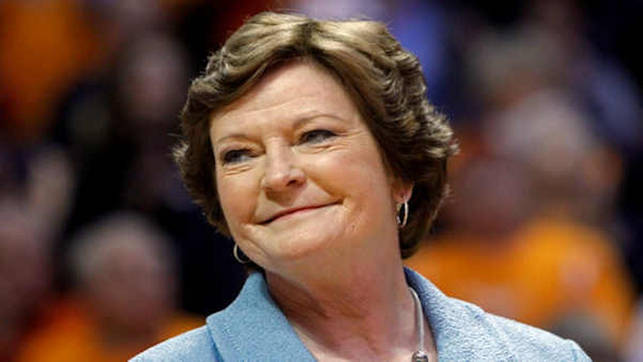 In this Jan. 28, 2013, file photo, former Tennessee womens basketball coach Pat Summitt smiles as a banner is raised in her honor  (AP Photo/Wade Payne, File)