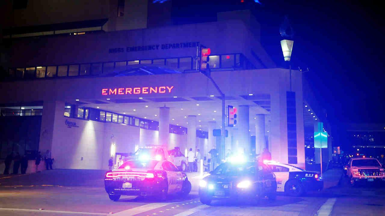 Emergency responder vehicles sit outside of the emergency room at Baylor University Medical Center, Friday, July 8, 2016, in Dallas.Tony Gutierrez