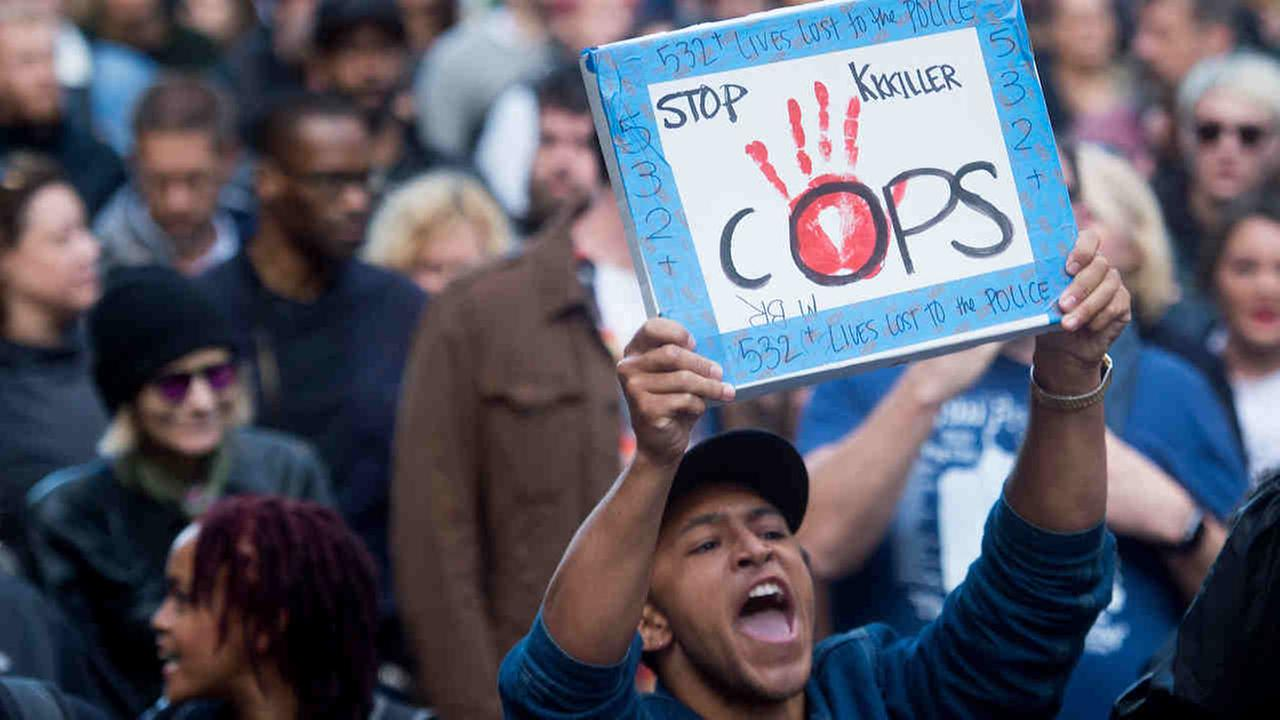 A demonstrator yells while marching with hundreds of protesters against the recent fatal shootings by police of black men in San Francisco on Friday, July 8, 2016.Noah Berger