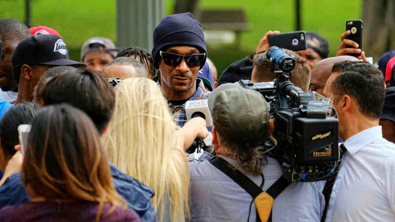 Rapper Snoop Dogg is surrounded by media during a march in support of unification outside of the ceremony for the latest class of Los Angeles Police recruits in Los Angeles Friday.Richard Vogel