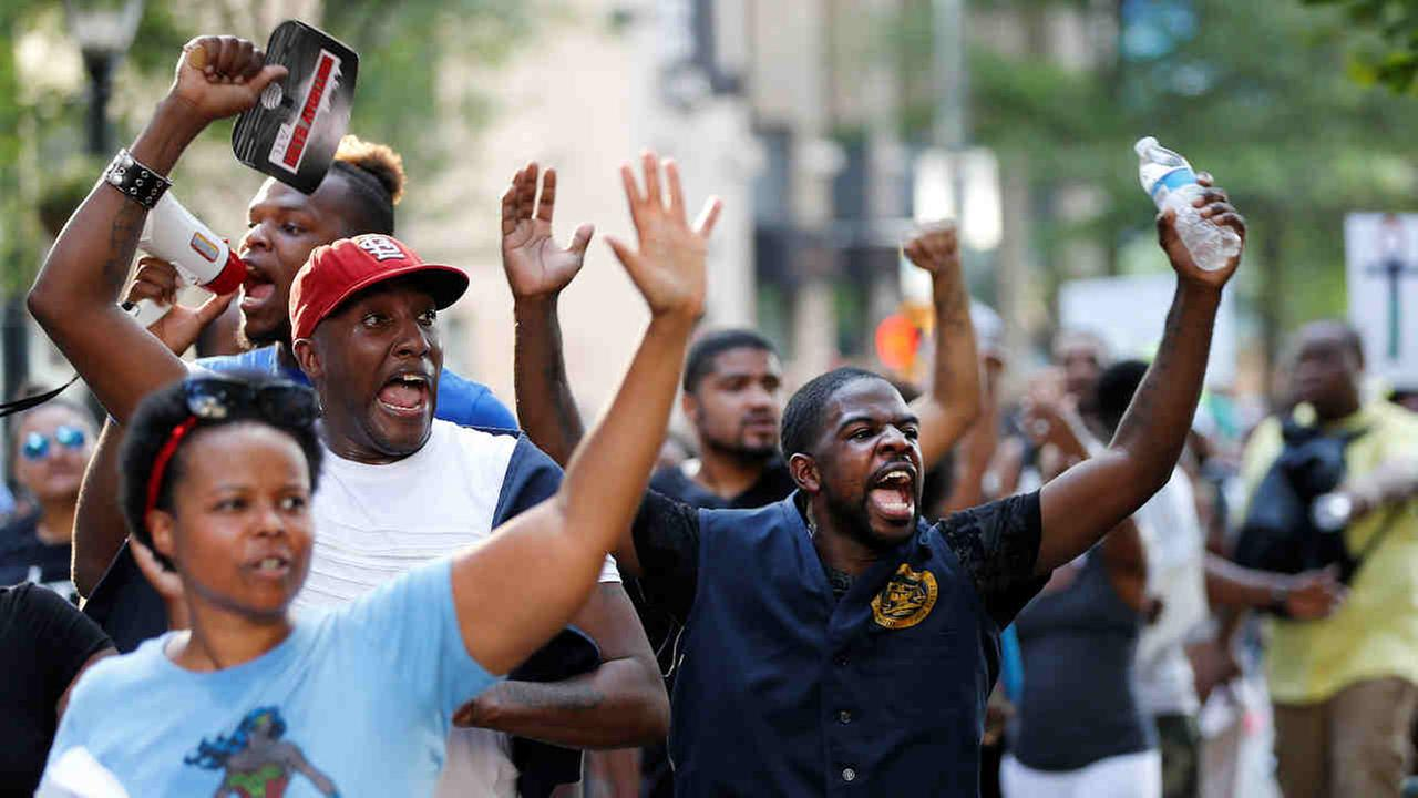 Demonstrators march through downtown Atlanta to protest the shootings of two black men by police officers, Friday, July 8, 2016.Mike Stewart