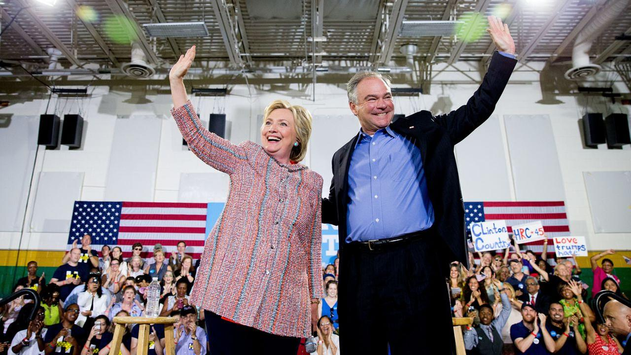 Democratic presidential candidate Hillary Clinton, and Sen. Tim Kaine, D-Va., participate in a rally at Northern Virginia Community College in Annandale, Va., July 14, 2016.