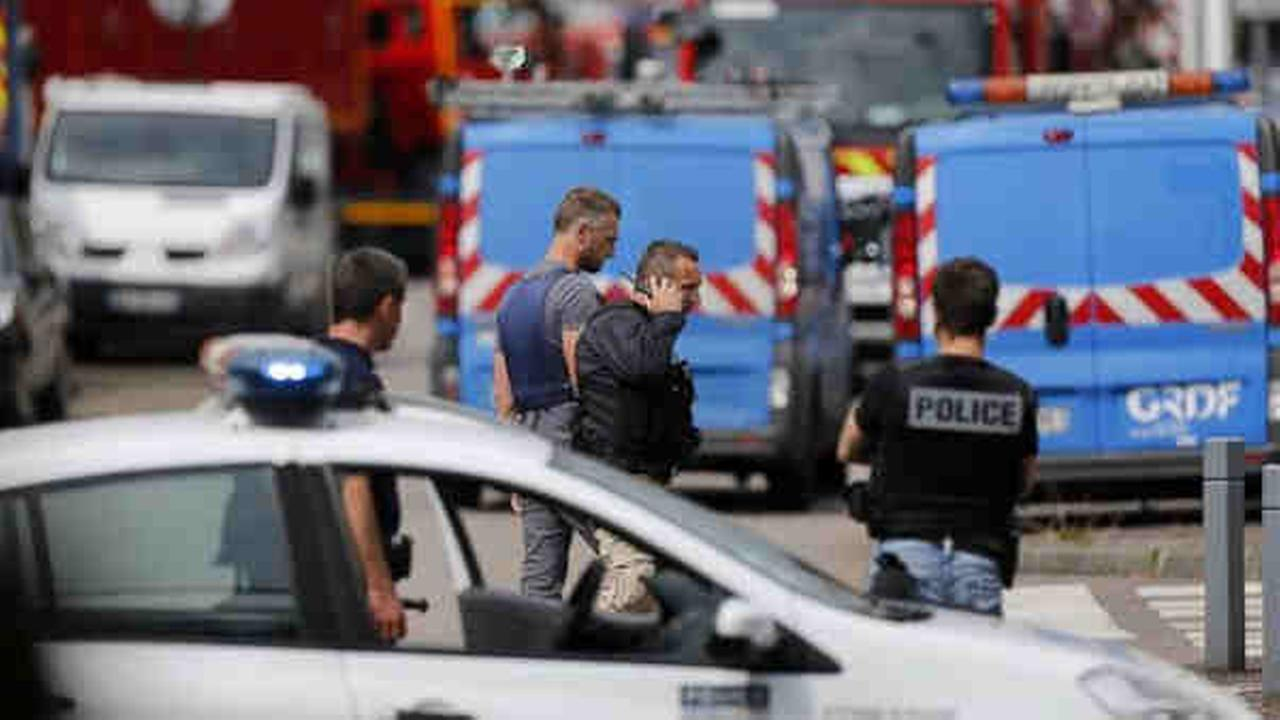 Two attackers seized hostages Tuesday in a church near the Normandy city of Rouen, killing a priest by slitting his throat before being killed by police, French officials said.