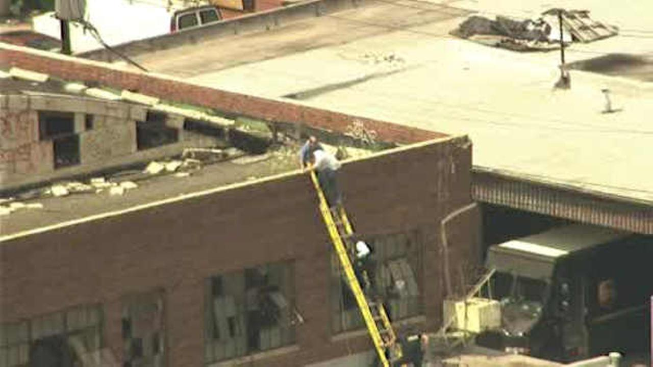 2 rescued from roof after man was barricaded in Newark warehouse