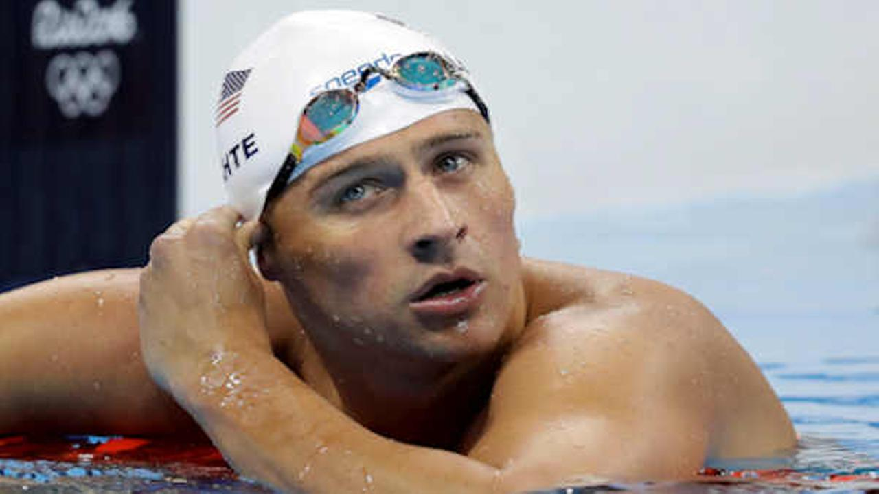 Ryan Lochte checks his time in a mens 4x200-meter freestyle heat during the swimming competitions at the 2016 Summer Olympics.   (AP Photo/Michael Sohn)