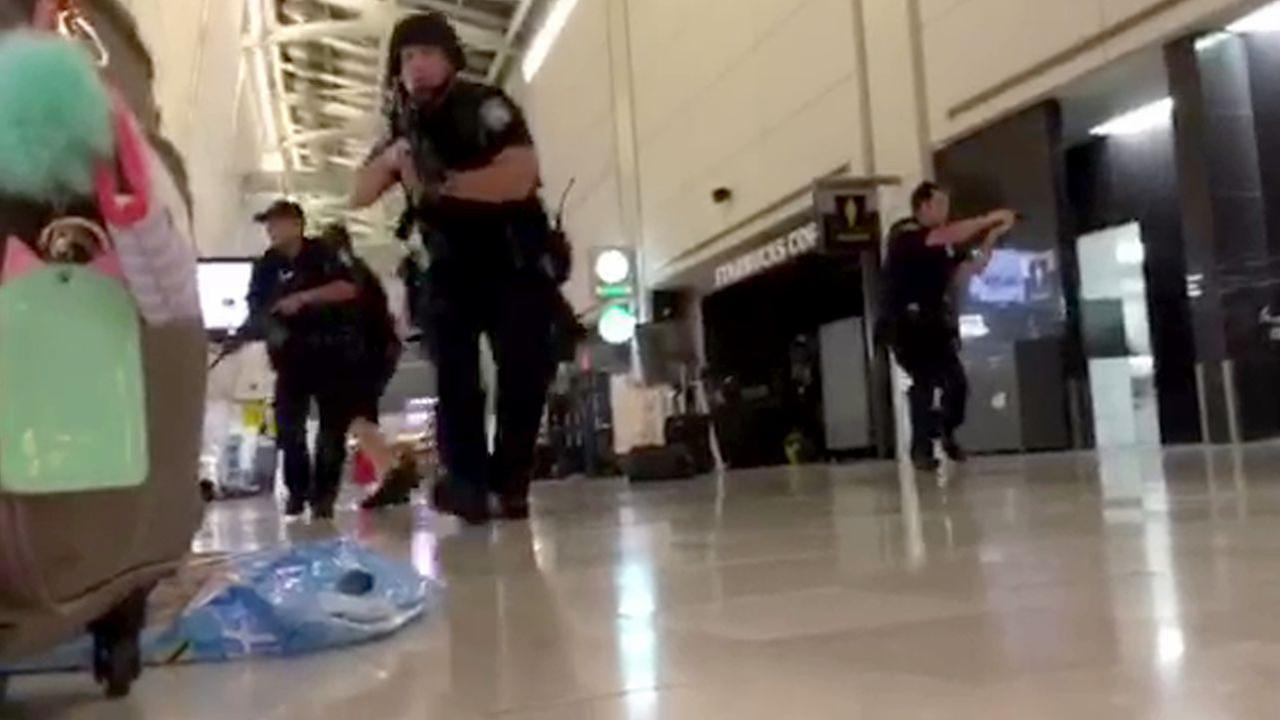 Video shows panic, tense moments inside JFK Airport after gun scare