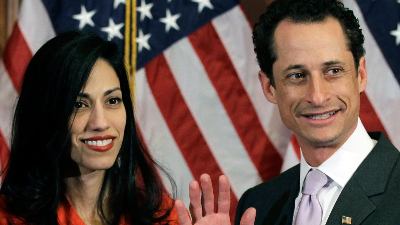 n this Jan. 5, 2011, file photo, Anthony Weiner and his wife Huma Abedin pose for photographs after the ceremonial swearing in of the 112th Congress on Capitol Hill in Washington.