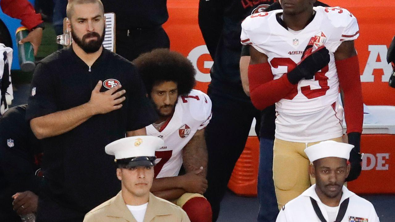 Colin Kaepernick , quarterback of the San Francisco 49ers , kneels during performance of the National Anthem before a preseason game against the San Diego Chargers on Sept 1, 2016.