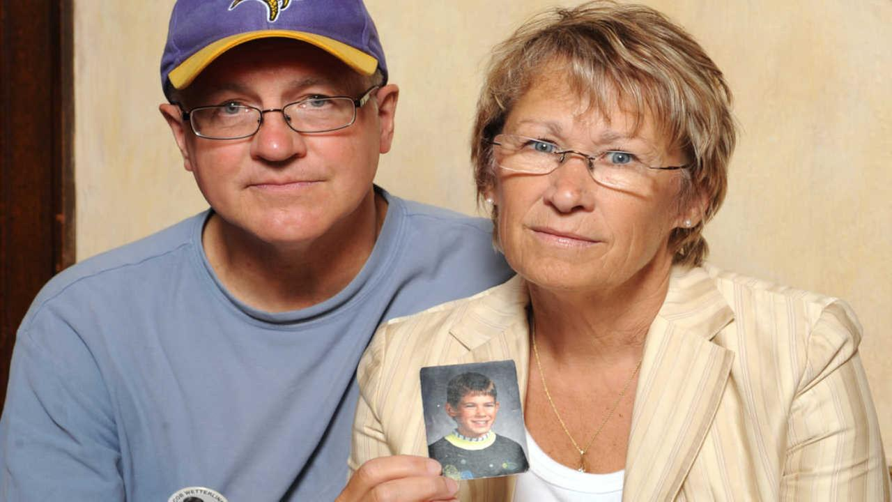 In this Aug. 28, 2009, file photo, Patty and Jerry Wetterling show a photo of their son Jacob Wetterling, who was abducted in October of 1989 in St. Joseph, Minn,