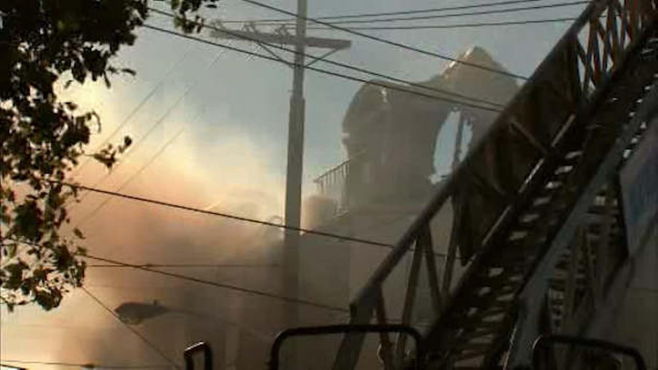 Child, 3 adults, dog rescued from third-floor balcony in Newark fire