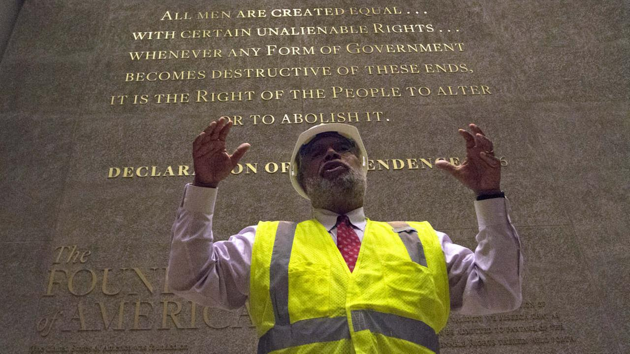 Museum Director Lonnie Bunch stands in front of an engraved wall at the Smithsonians National Museum of African American History and Culture in Washington during a media preview.