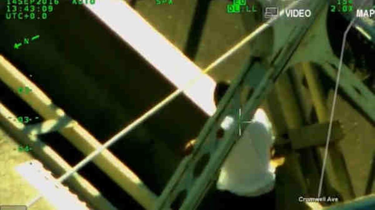 Police rescued a man from a Harlem Bridge Wednesday.
