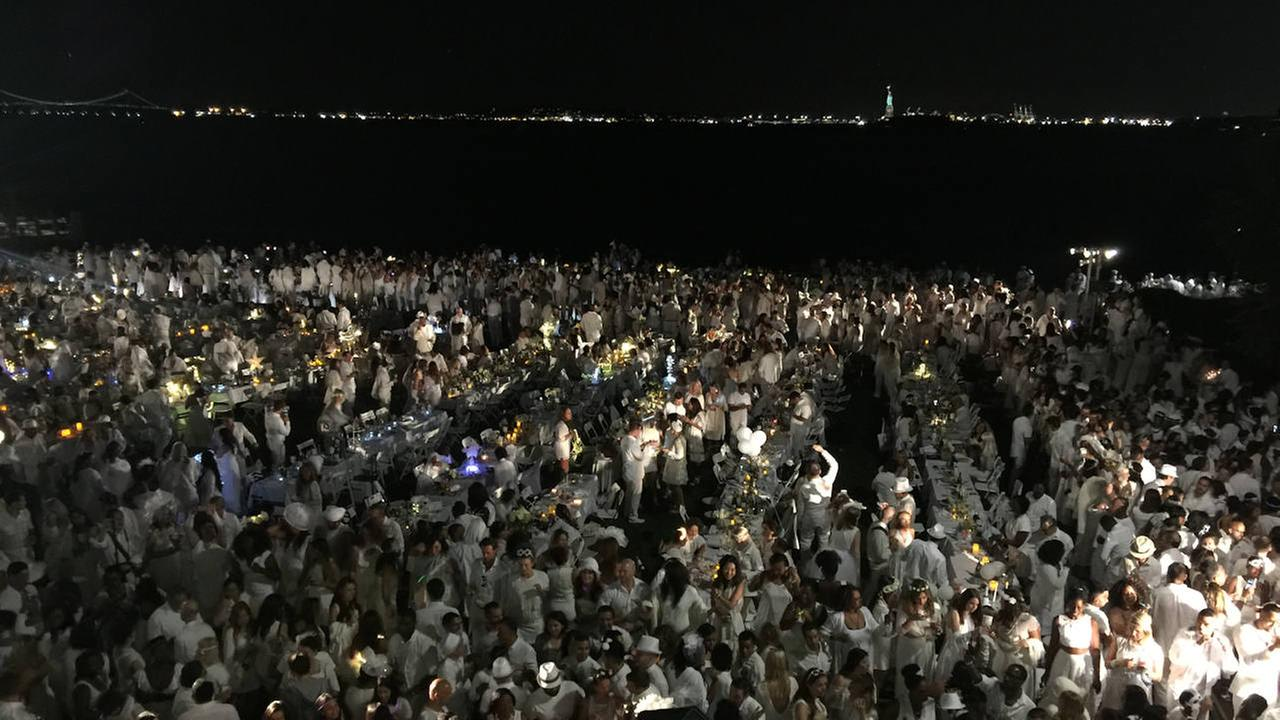 Thousands of people converge on Battery Park for 'Diner en Blanc' outdoor dinner party