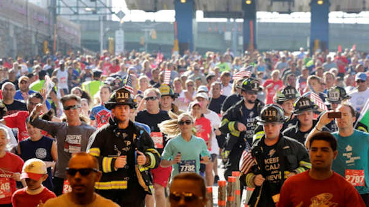 Firefighters and runners participate in the annual Stephen Siller Tunnel to Towers memorial event, Sunday, Sept. 28, 2014 (AP Photo/Mark Lennihan)