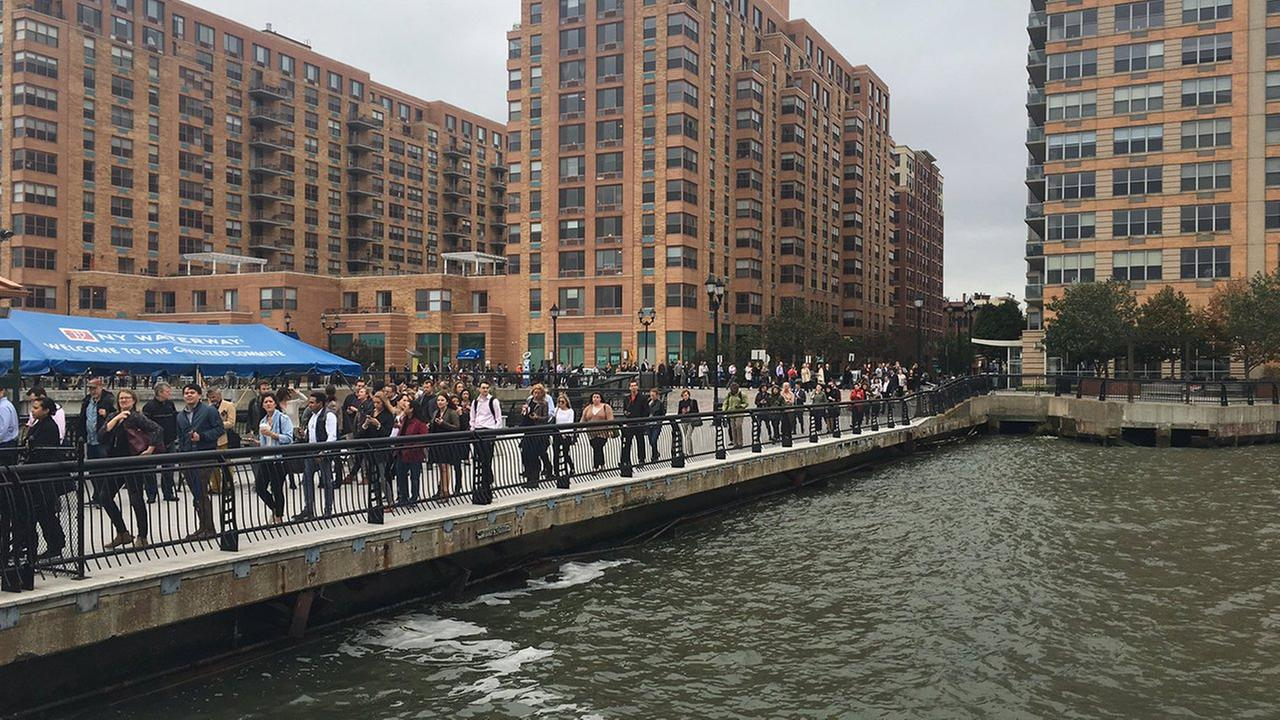 Photo from @HiddenHoboken via Twitter.  This is the line for the 14th Street ferry - on a normal day, line does go to the end of the pier, but maybe not as far down block.