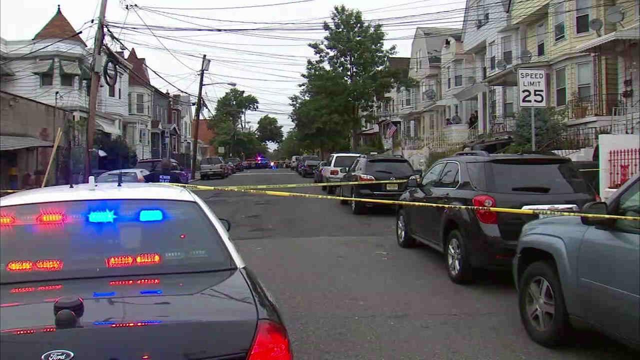 At least one person was shot by police chasing after a group of suspect on foot in Newark Friday morning.
