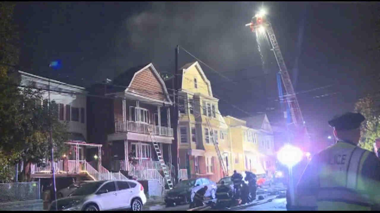 A four-alarm fire injured two firefighters and burned through at least two homes in Bayonne.