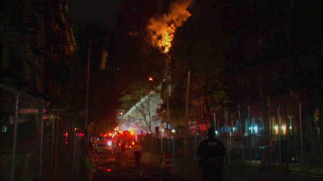 A five-alarm fire is burning through a building on the Upper East Side.