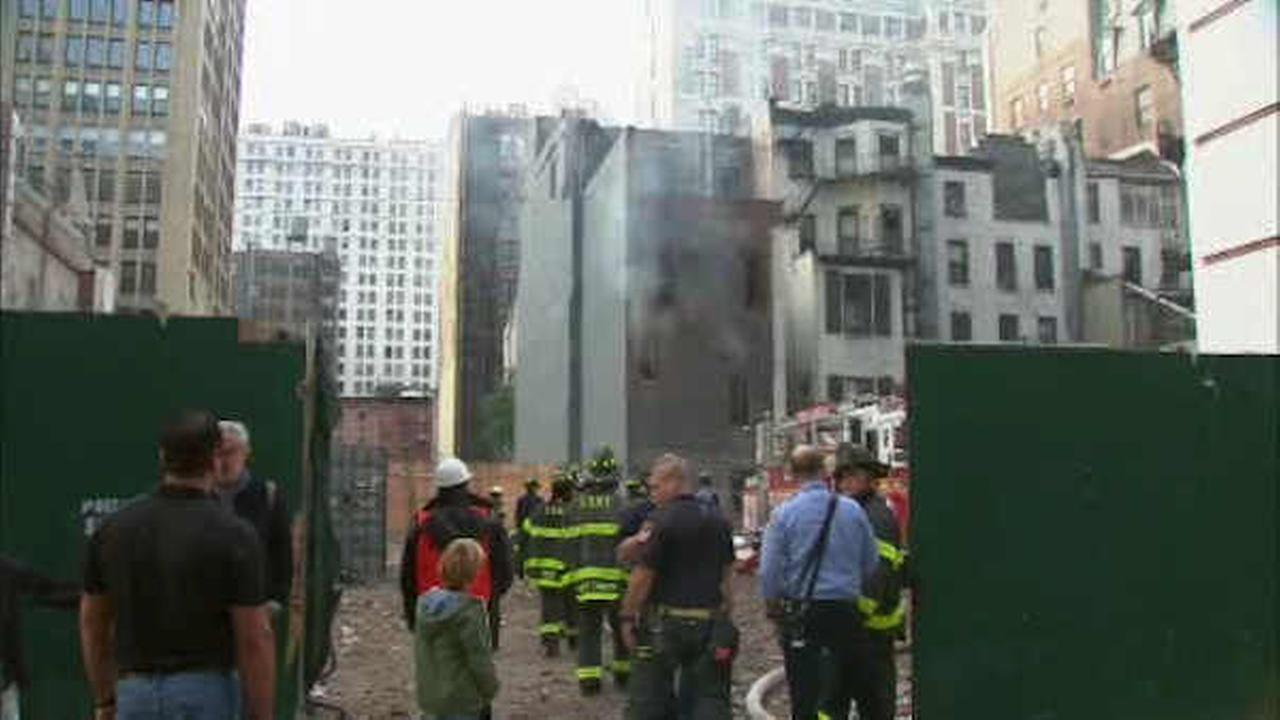 6 firefighters injured battling fire at Midtown Manhattan building
