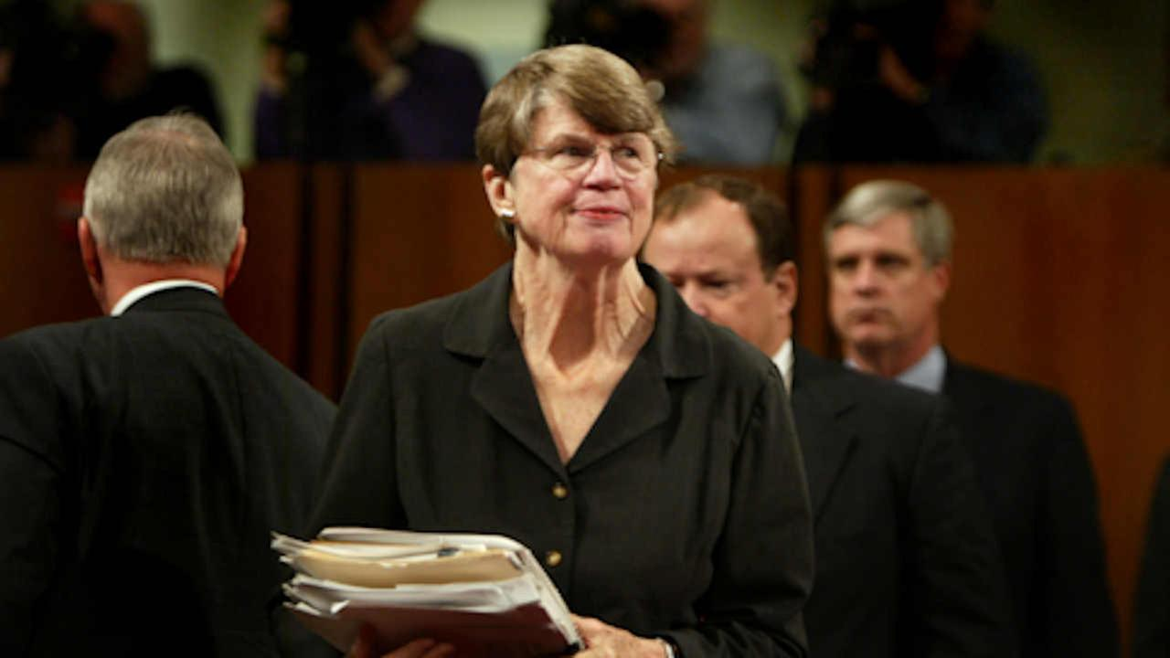 Janet Reno walks towards the witness table to testify before the commission investigating the Sept. 11 attacks Tuesday, April 13, 2004 AP Photo/Charlie Dharapak)