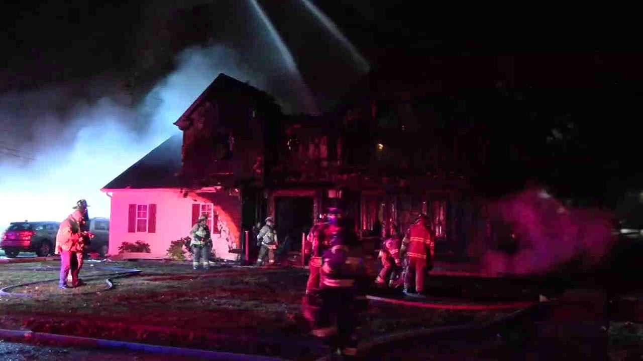An off-duty Suffolk County police officer helped rescue a family of four from a house fire in Centereach Friday night.