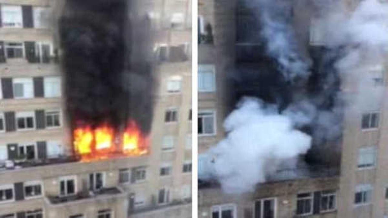Flames shoot out of Lower Manhattan high-rise; no injuries reported