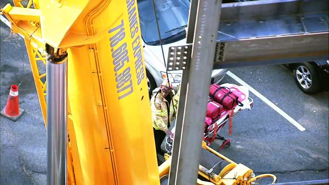 Workers trapped when beam falls at NYC construction site