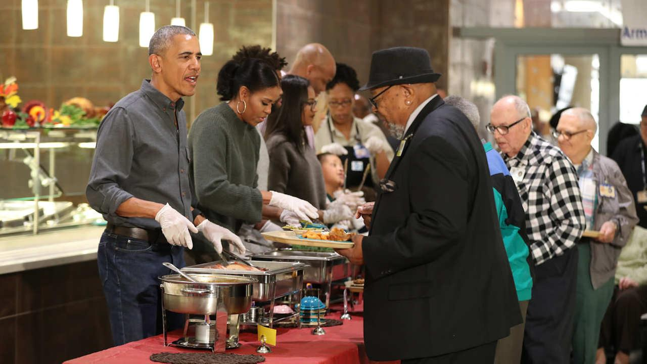 President Barack Obama with first lady Michelle Obama serve Thanksgiving meals to residents of the Armed Forces Retirement Home on Wednesday, Nov. 22, 2016