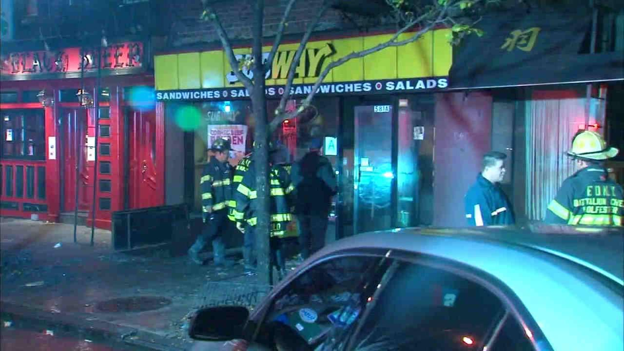 A three-alarm fire in a Murray Hill building left four people with minor injuries.