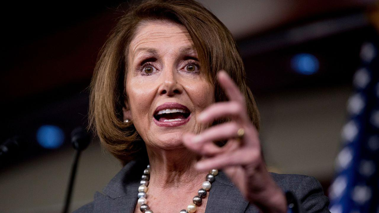 Pelosi broadens leadership team in fight to retain post