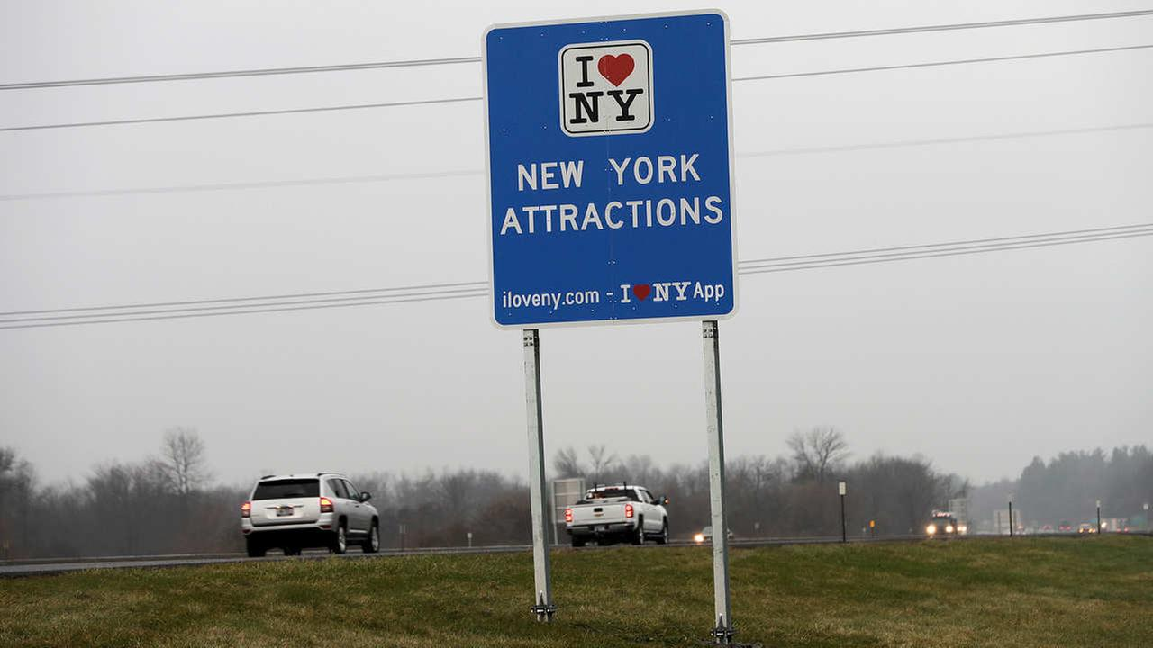 Vehicles pass an I Love New York sign on the New York State Thruway, Tuesday, Nov. 29, 2016, in Utica.
