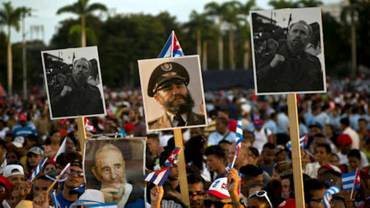 People hold pictures of the late Fidel Castro during a last homage to him at Antonio Maceo plaza in Santiago, Cuba (AP Photo/Ramon Espinosa)