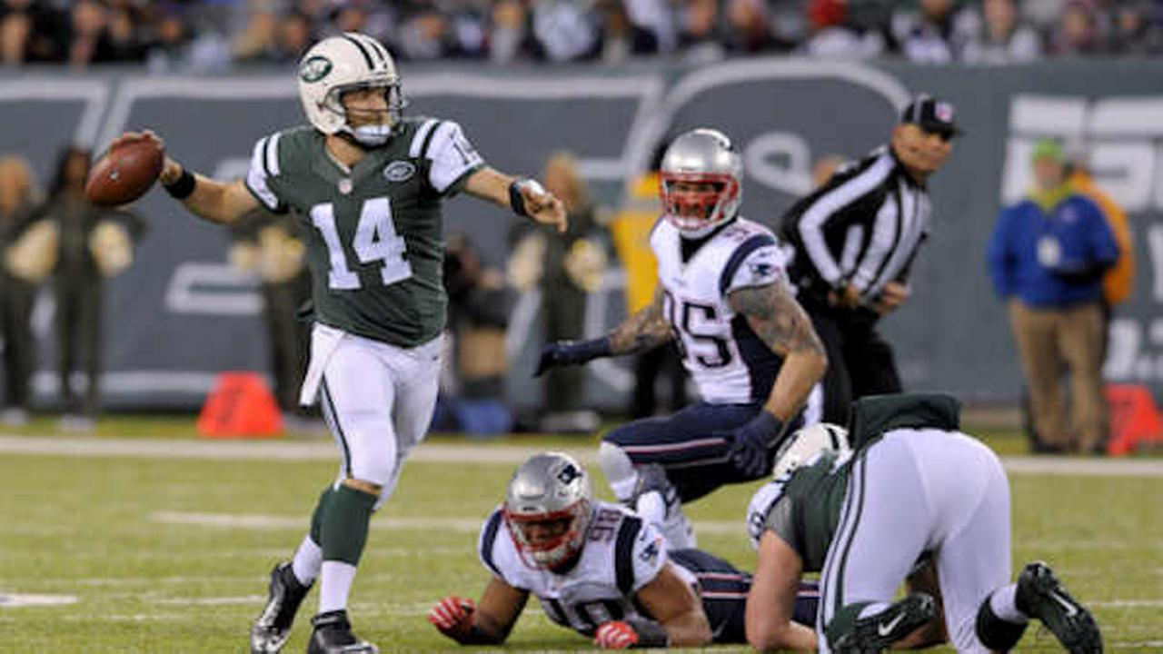 Jets quarterback Ryan Fitzpatrick (14) throws on the run against the New England Patriots during the first quarter Nov. 27  (AP Photo/Bill Kostroun)