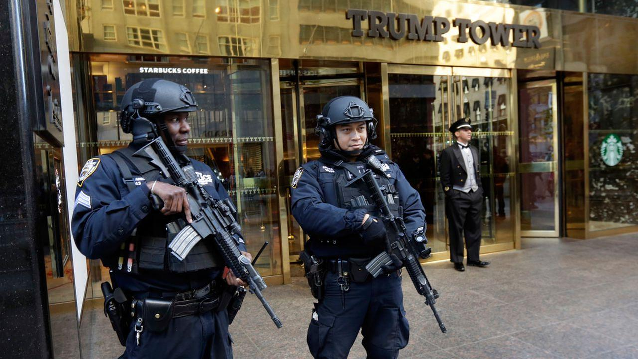 New York City Police officers guard the front of Trump Tower, in New York, Friday, Nov. 11, 2016.