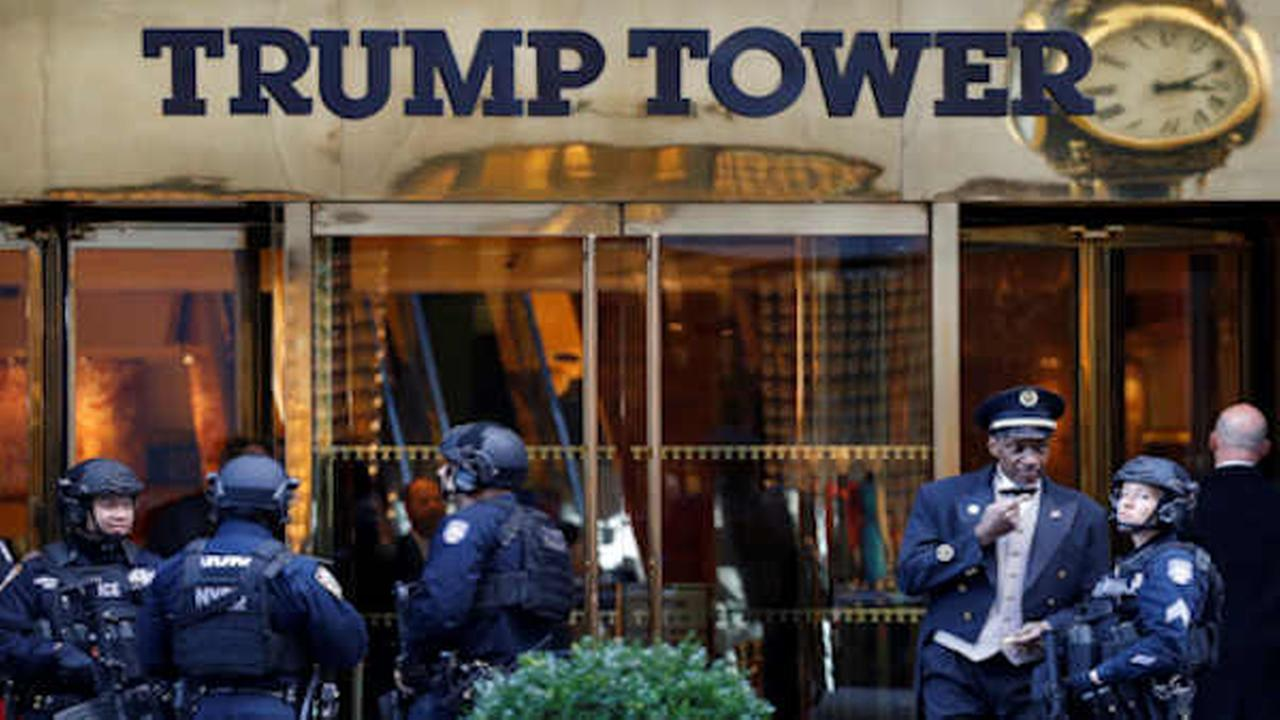 Members of the New York Police Departments counterterrorism unit guard Trump Tower (AP Photo/Mark Lennihan)