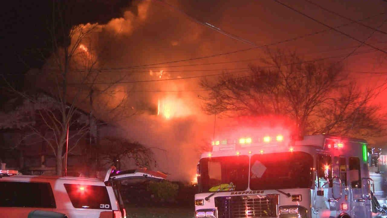 Fire tore through a house on Long Island early Friday morning.