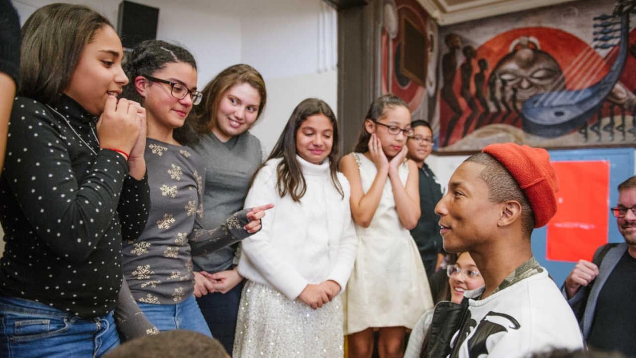 R&B star Pharrell Williams surprises Washington Heights middle school